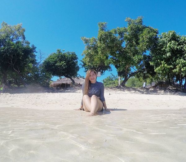 Sand Beach Summer Tree Day Vacations Adult One Person Low Section Adults Only Nature Outdoors Blue Clear Sky People Desert One Woman Only Human Body Part Arid Climate Potipotisland Adults Only Travel Destinations Vacations Clear Sky Only Women