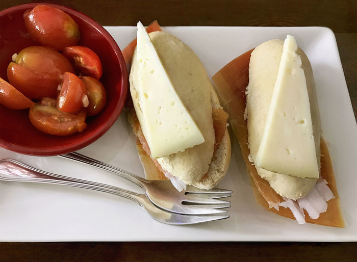 Tapas, mini sandwiches, with bread, tomatoes, cheese and ham Appetizer Bread Cheese Close-up Food Food And Drink Fork Freshness Ham Healthy Eating Indoors  Mini Sandwich No People Plate Ready-to-eat Serving Size SLICE Table Tapas Tomatoes