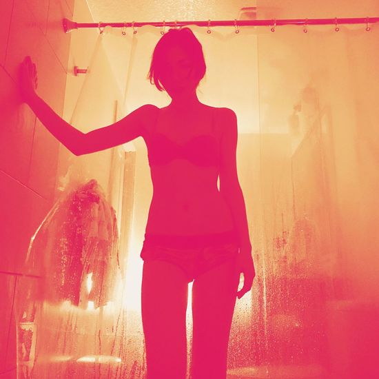 One Person Real People Standing Rear View Pink Color Shadow Women Lifestyles Outdoors Day One Woman Only Adult People Shower Adults Only Young Adult Outline Silhouette Bathtub Color Fashion Photography Intimate Girl Body Curves  EyeEm Selects