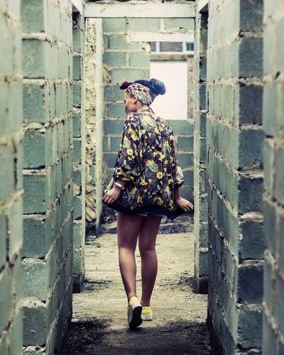 Riffi || Concrete Wall Black Girl Walking Weekly_feature Conceptual Hair Bun