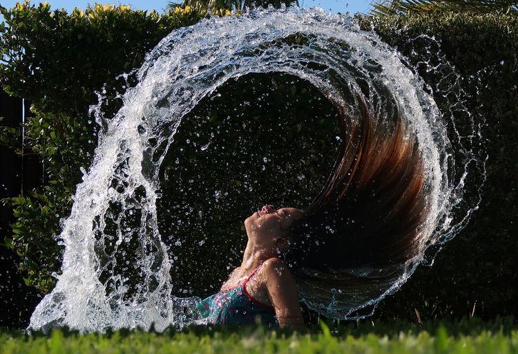 Full frame shot of water splashing on grass