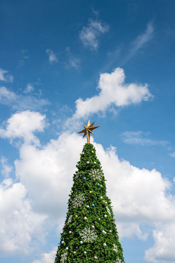 Celebration Christmas Christmas Decoration Christmas Tree Cloud - Sky Day Low Angle View No People Outdoors Sky Tree Topper