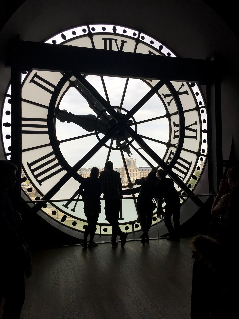 group of people, clock, time, roman, real people, roman numeral, clock face, architecture, women, lifestyles, medium group of people, men, built structure, indoors, group, adult, people, silhouette, leisure activity, circle, minute hand, hour hand