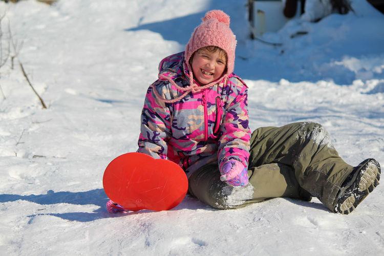 Portrait of cute girl in snow