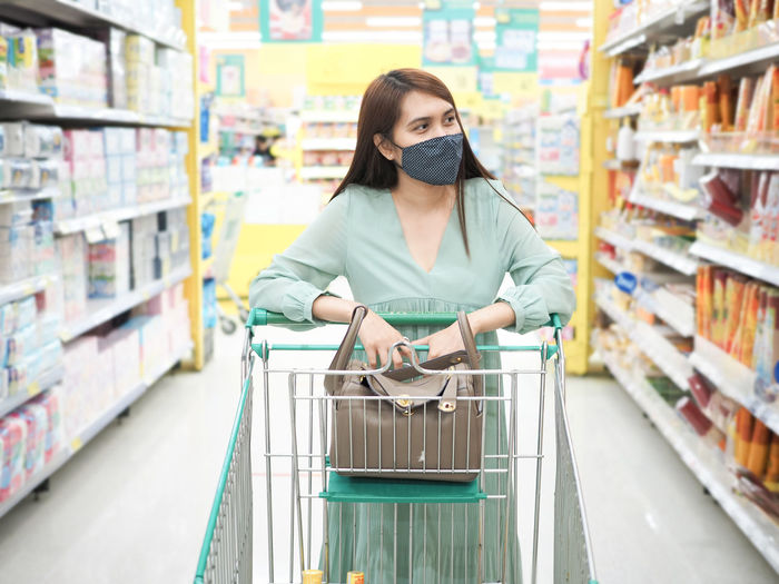 Young woman looking away at store