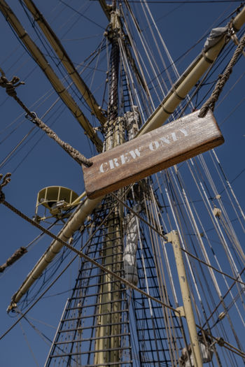 Crew only- Blue Built Structure Clear Sky Day Low Angle View Mast Metal Nature Nautical Vessel No People Outdoors Pole Rigging Rope Sailboat Ship Sky Sunlight Tall - High