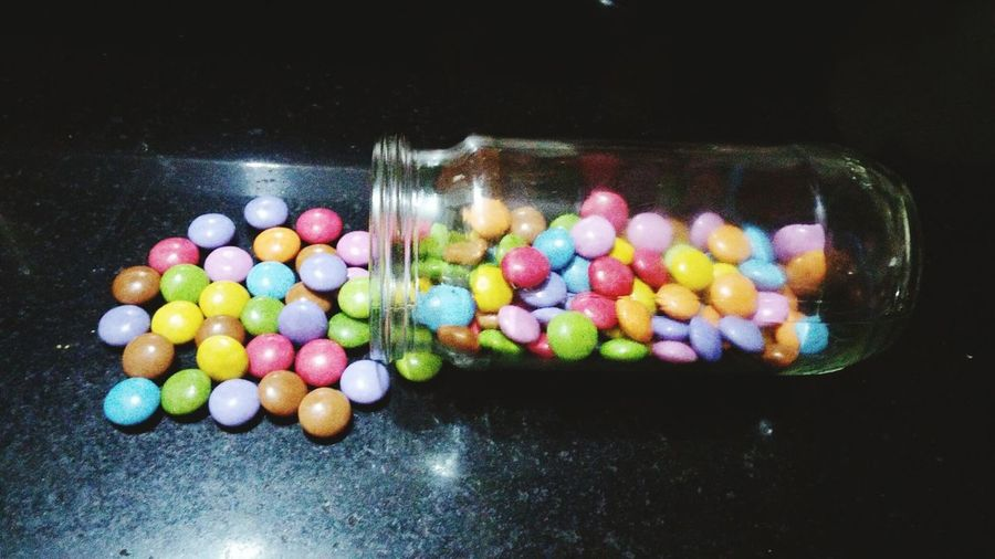Multi Colored Variation Large Group Of Objects No People Sweet Food Choice Temptation Close-up Indoors  Gems Glass Bottle Gems In Bottle Ready-to-eat Marbles Chocolate Colourful Eating Eating Gems Colourful Easter Eating Circle Eating Marbles Temptation