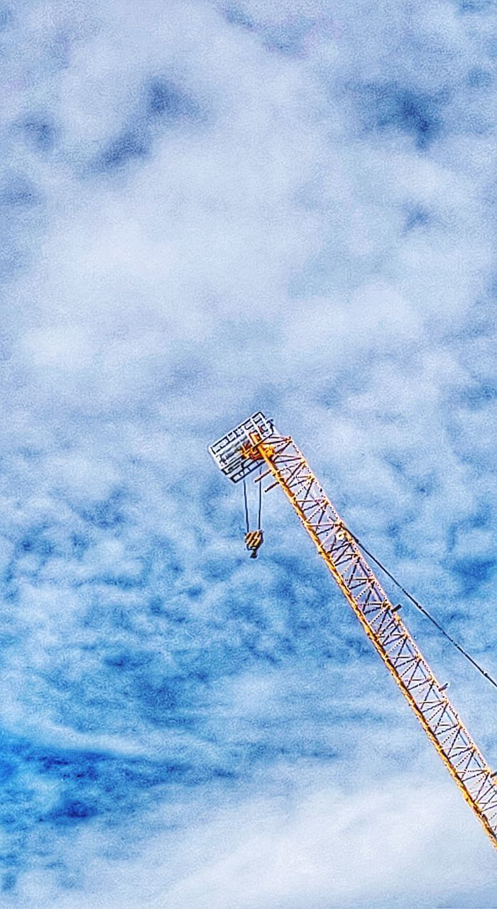 LOW ANGLE VIEW OF CRANE AGAINST SKY AT CONSTRUCTION SITE