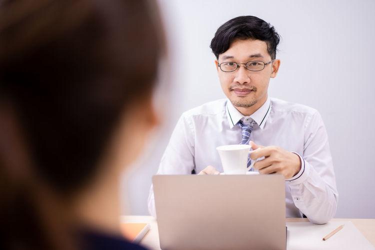 Portrait of man working on laptop