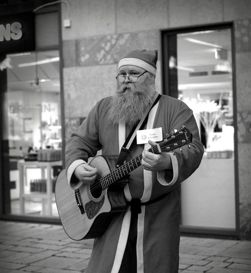 Christmas City Santa Sweden Västerås Beard Blackandwhite Carusell Casual Clothing Electric Guitar Eyeglasses  Focus On Foreground Front View Guitar Home Interior Indoors  Leisure Activity Lifestyles Looking At Camera Mature Adult Mature Men Men Monotone Music Musical Instrument Musician Night One Person Playing Plucking An Instrument Portrait Real People Skill