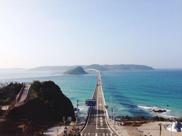 Tsunoshima ohashi bridge over sea against clear sky
