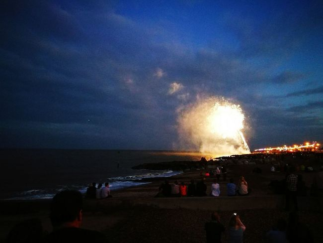 Fireworks on the Beach Armed Forces Day Beach Sky Sea Water People Outdoors Seafront View Sea And Sky Firework Display Exploding Celebration Large Group Of People People Watching Fireworks