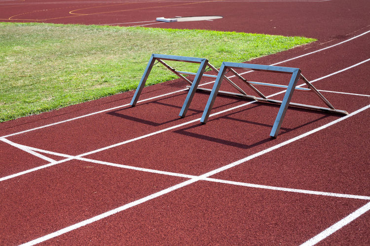 EyeEmNewHere Hurdles Athletic Fields Day Eye4photography  Hurdle Hurdle Practice No People Outdoors Playground Playing Field Running Track Sport Sport Venue Sports Track