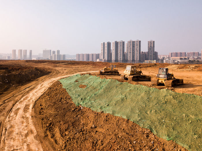 Architecture Building Exterior Built Structure City Cityscape Construction Site Day Development Digging Industry No People Outdoors Quarry Sky