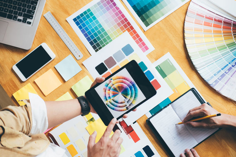 Art And Craft Colleague Color Chart Color Swatch Colorful Creativity Desk Directly Above Graphic Design Hand High Angle View Holding Human Body Part Human Hand Indoors  Men Multi Colored Pantone Paper People Publication Swatch Table Women Wood - Material