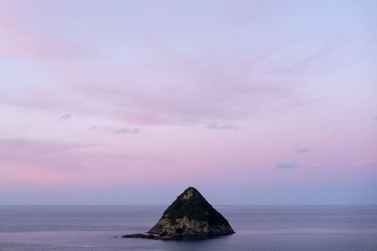 Sea Sky Water Cloud - Sky Beauty In Nature No People Sunset Scenics - Nature Tranquil Scene Nature Tranquility Land Horizon Over Water Idyllic Horizon Rock Solid Pink Color Dusk Outdoors Purple