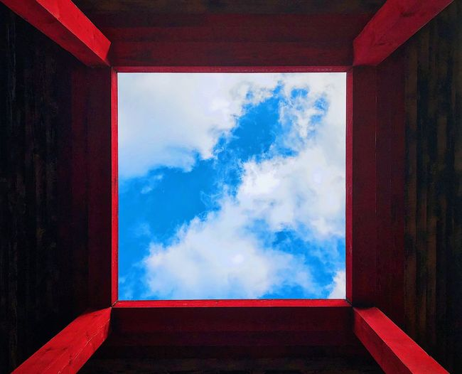 Low angle view of window against sky
