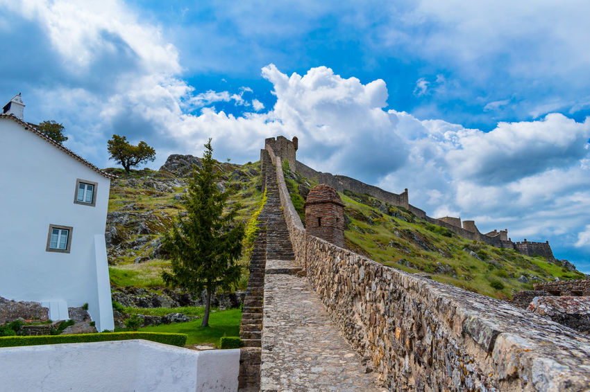 Castelo de Marvão Ancient Ancient Civilization Archaeology Architecture Building Building Exterior Built Structure Cloud - Sky Day Direction Footpath History Mountain Nature No People Outdoors Plant Sky Stone Wall The Past The Way Forward Travel Destinations Tree Wall