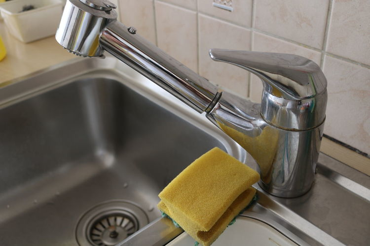High Angle View Of Faucet On Kitchen Sink