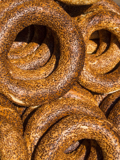 Delicious fresh Turkish bagels (also called simits) Backgrounds Bagels Close-up Day Delicious Deterioration Extreme Close-up Fresh Full Frame Metal No People Old Orange Color Outdoors Rusty Simit Textured  Turkish Weathered