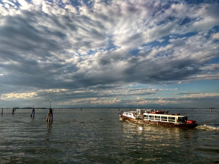 Let's go Cloud - Sky Sea Water Nautical Vessel Transportation Sunset Outdoors Sky No People Nature Scenics Horizon Over Water Day Waterbus Venice, Italy Lagoon Dramatic Sky Perspective Journey Holidays Light Ship Intense Stream Public Transportation Breathing Space Your Ticket To Europe Investing In Quality Of Life