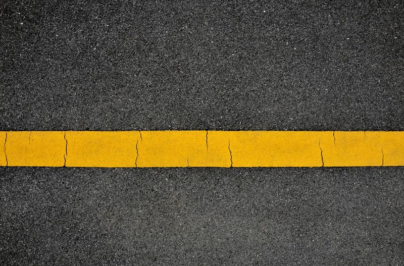 High angle view of yellow road sign on street