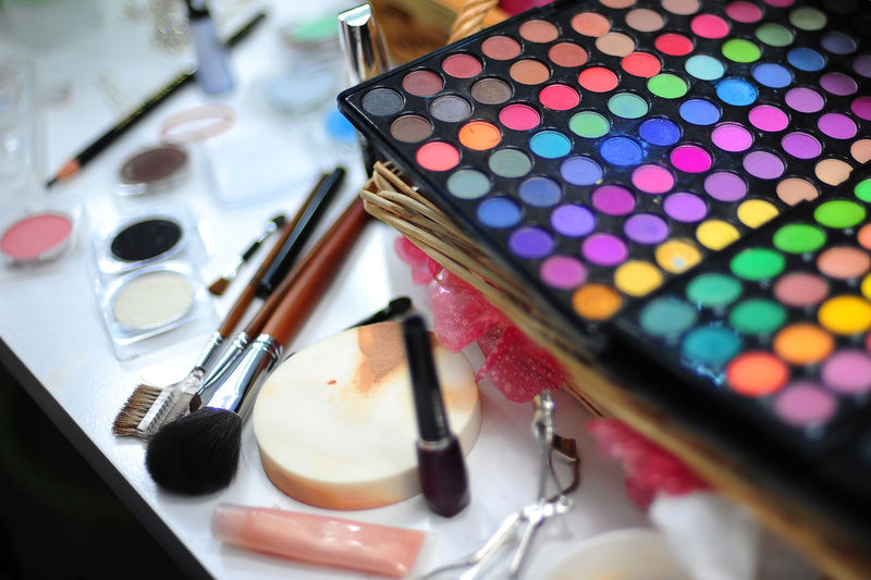 High angle view of make-up cosmetics on table