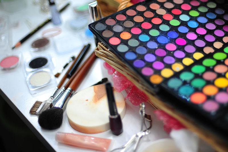 High Angle View Of Make-Up Cosmetics On Table