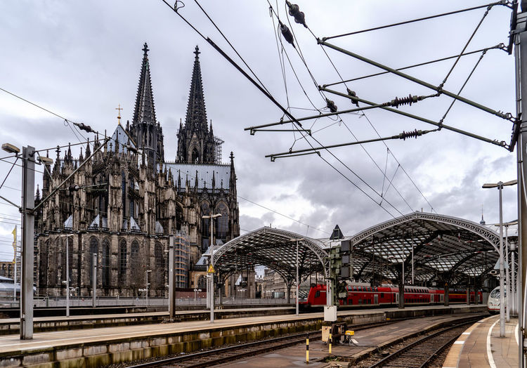 Rail Transportation Sky Built Structure Architecture Transportation Track Railroad Track Building Exterior Cloud - Sky Mode Of Transportation Nature Train Public Transportation Train - Vehicle Day Railroad Station Religion Place Of Worship Building Outdoors Electricity