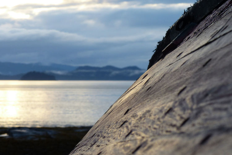 Wood Adventure Beauty In Nature Boat Close-up Clouds Clouds And Sky Day Mountain Mountain Range Nature No People Old Wood Outdoors Rough Scenics Sea Sea And Sky Seascape Sky Sun Set Textured  Tranquility Water Wood - Material