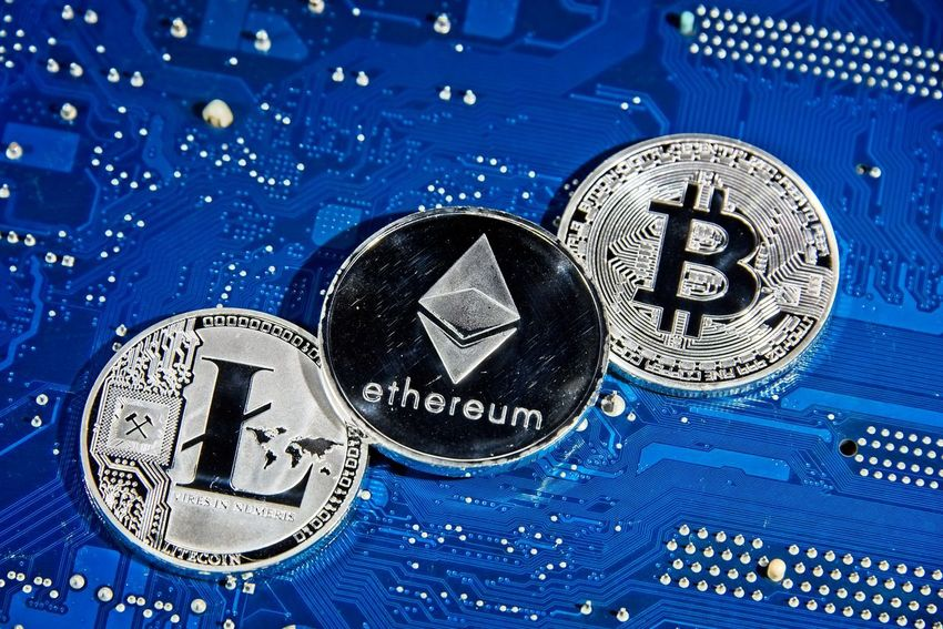 Shining silver metal BTC LTC ETH Bitcoin Litecoin Ethereum coins on computer mother board BTC Gold LTC Mother Board Taxi Virtual Reality Bitcoin Bitcoins Blockchain Board Circuit Coin Computer Crypto Cryptocurrency Cryptography Digital Eth Ether Ethereum Exchange Finance Litecoin Metal Silver