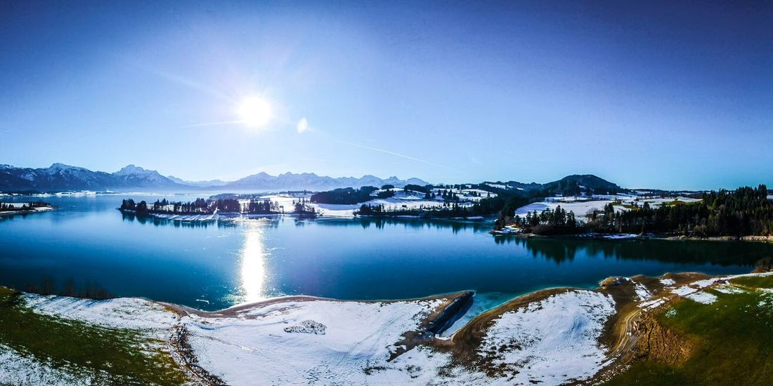 Forggensee Bavaria German Forggensee Bavaria Winter Cold Temperature Nature Water Snow Mountain Scenics Beauty In Nature Lake Sky Frozen Outdoors Ice Tranquil Scene Tranquility Sunlight No People Clear Sky Mountain Range Blue