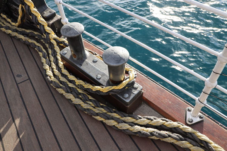 Nautical Vessel Rope Transportation Water Mode Of Transportation Sea Cleat Boat Deck Sailing Deck No People Tied Up Strength Wood - Material Nature High Angle View Day Ship Pier Outdoors Sailboat Yacht Passenger Craft Luxury
