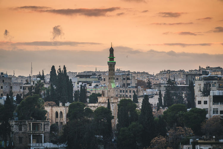 Cityscape with minaret at sunset