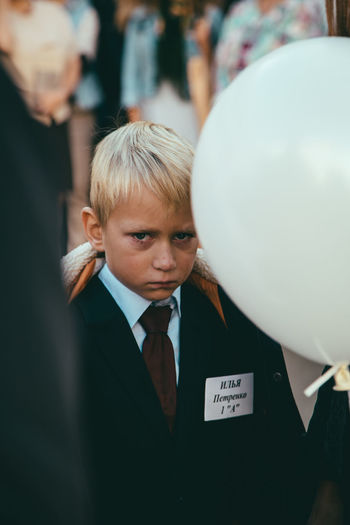 First day in school Balloon Blond Hair Boys Business Child Childhood Formalwear Front View Leisure Activity Lifestyles Males  Men Menswear One Person Portrait Real People Suit Waist Up Well-dressed