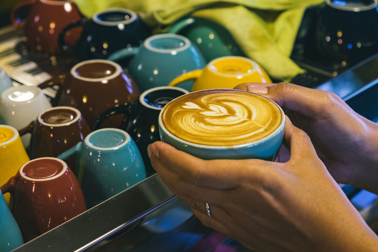 A cup of Cappucino Cafe Cappuccino Close-up Coffee - Drink Coffee Cup Day Drink Focus On Foreground Food And Drink Freshness Froth Art Frothy Drink Holding Human Body Part Human Hand Indoors  Men One Person People Real People Refreshment