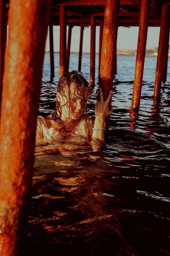 Boy on pier over sea