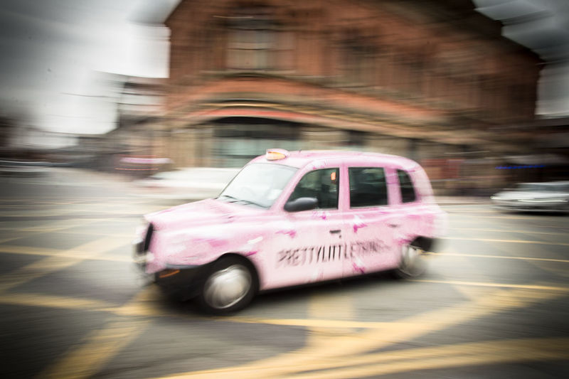 #England #Manchester Architecture Blurred Motion Building Exterior Built Structure Car City City Life Day Land Vehicle Mode Of Transportation Motion Motor Vehicle No People on the move Outdoors Pink Color Road Speed Street Transportation