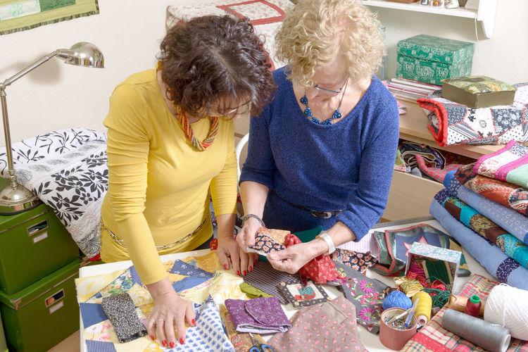 Senior women looking at textile