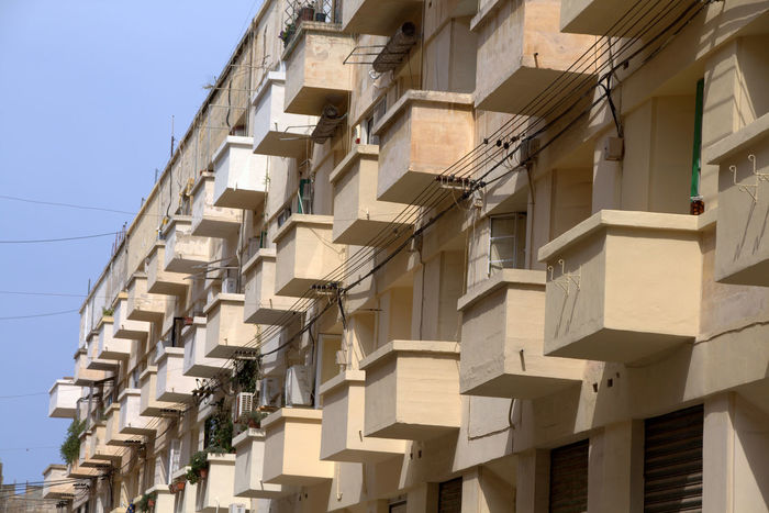 Apartment Architectural Feature Architecture Balcony Building Exterior Building Story Built Structure City City Life Clear Sky Colors And Patterns Day High Section In A Row Low Angle View No People Outdoors Repetition Residential Building Residential District Residential Structure Sky Tall - High Window