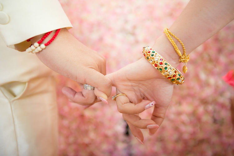 Wedding photo / hope you like it Adult Bonding Bracelet Close-up Couple - Relationship Emotion Finger Flower Flowering Plant Hand Holding Human Body Part Human Hand Jewelry Love Midsection Positive Emotion Ring Togetherness Two People Women
