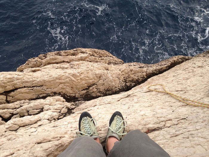 Climbing above the sea between Marseille and Cassis Climb EyeEmNewHere Marseille Alpinism Calanques  Climbing Human Body Part One Person Rock - Object Rocks Sea Space Sport Vertigo Water