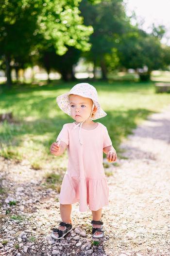 Full length of cute girl standing on land