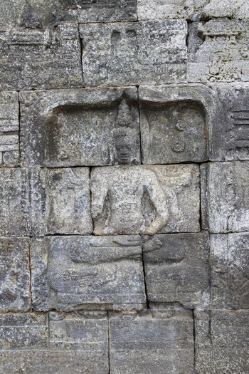 Beautiful bas-relief wall decor with Buddha carved in stone at Borobudur Temple, Yogyakarta, Indonesia Ancient Ancient Civilization Architecture Art And Craft Bas Relief Buddha Statue Built Structure Carving Carving - Craft Product Close-up Craft Day History Human Representation Male Likeness No People Old Representation Sculpture Stone Stone Material Stone Wall The Past