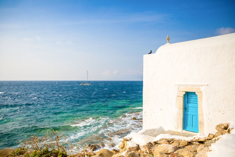 Mykonos Greece Sea Architecture Water Built Structure Horizon Sky Horizon Over Water Building Exterior Day Blue Nature Building Sunlight Scenics - Nature Beauty In Nature Beach Land No People Outdoors