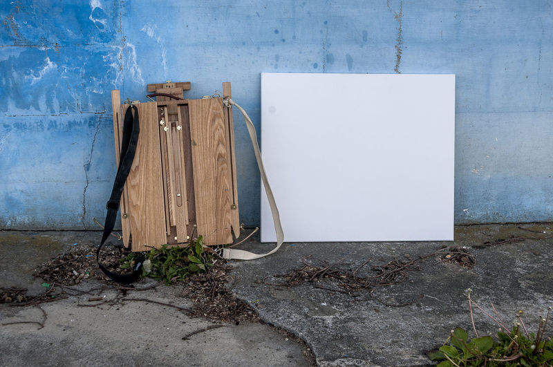 Empty canvas in front of weathered wall