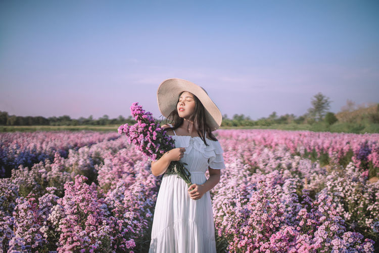 Woman standing on lavender field