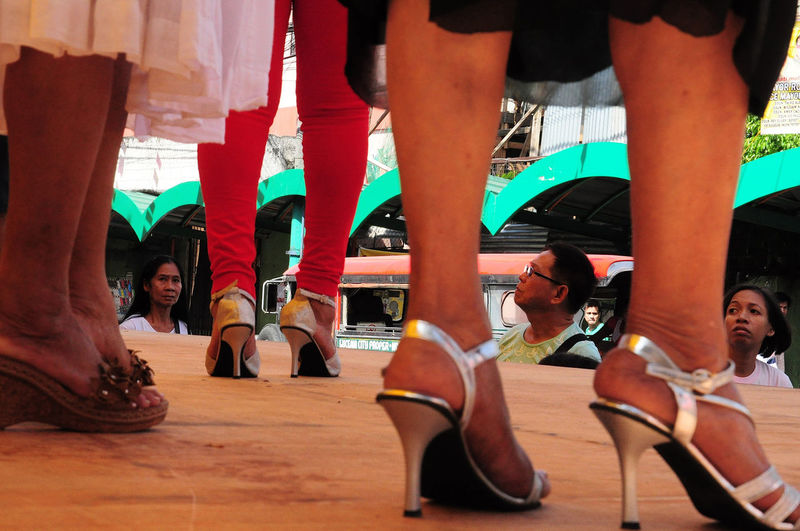 Head over heels: Flaneuring in Color City City Street Day Eyeem Philippines Flaneur Footwear Heels Leisure Activity Lucena City My City Philippines Quezon Quezon Province Street Street Photography Streetphoto_color Streetphotography Urban Urbanphotography Watching People