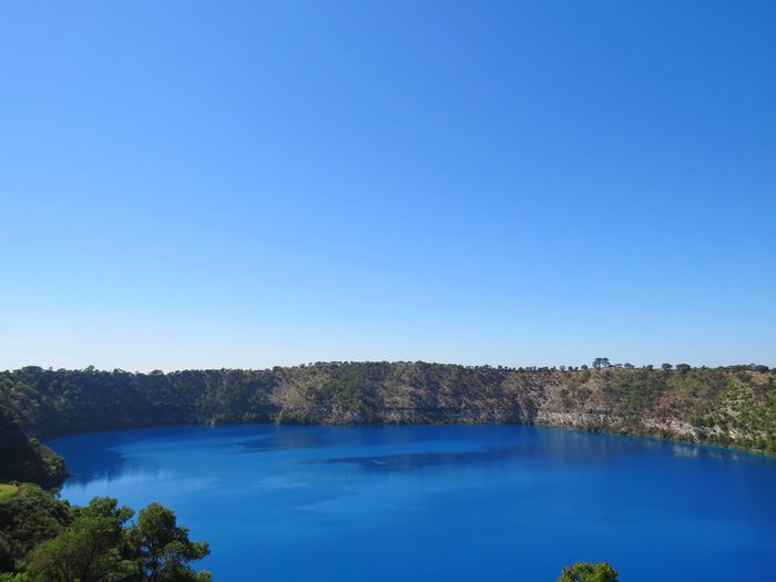 Blue Lake, Mount Gambier. No People Backgrounds Dormant Volcano Travel MOUNT Gambier Australia Volcanic Landscape Tree Water Clear Sky Blue Lake Sky Landscape Pine Woodland Volcanic Crater Volcano Standing Water