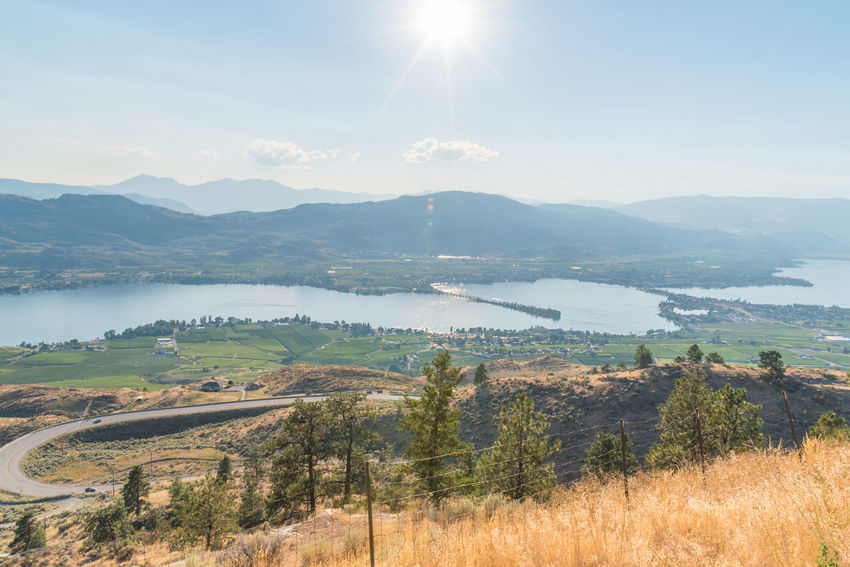 Town of Osoyoos and Osoyoos Lake from Anarchist Mountain Viewpoint in summer Afternoon Anarchist Mountain Anarchist Mountain Lookout August Blue Skies British Columbia, Canada Orchards Osoyoos Osoyoos Lake Sun Star View Vineyards  Fields Landscape Mountain Range Nature Outdoors South Okanagan Summer Sun Flare Sunlight Sunshine Town Valley Viewpoint